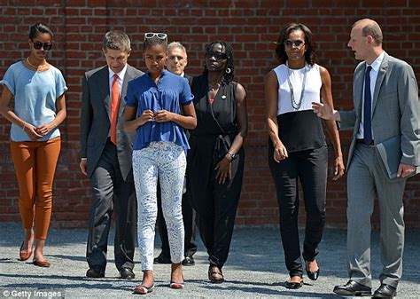 Michelle Obama takes her daughters to Berlin's Holocaust