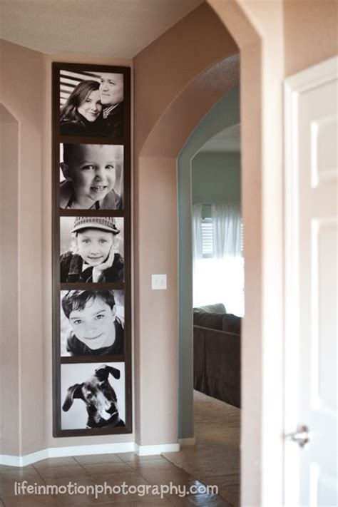 pictures stacked vertically at end of hallway to look like